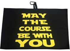 """The May The Course Be With You Waffle Golf Towel is 15"""" x 24"""", and a waffle weave microfiber material. It comes with a loop and carabiner clip to hook onto your golf bag. It is the perfect towel for cleaning your ball or golf clubs."""