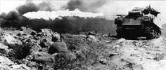 """A Marine flame throwing tank, also known as a """"Ronson"""", scorches a Japanese strongpoint at Iwo Jima"""