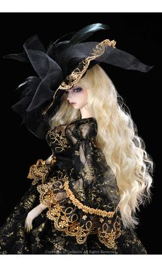 """ My emotions hide behind the wealth and fancy exterior, nobody would think a proper lady of my sature would fall victim to such a lowly crime. My personality masked behind my fancy veil, my feelings wither amogst the frill and feathers"" Hauntingly beautiful BJD doll"