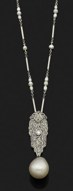 A natural pearl, diamond, white gold and platinium pendant