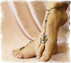 Tie the knot wearing our anchor pearl beaded barefoot sandals. Silver anchor and pearl foot jewelry that is simply beautiful for your nautical inspired beach wedding. Delicate pearl and seed beads on