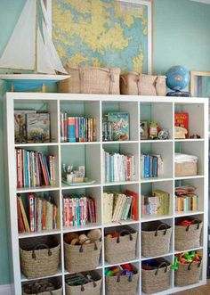 IKEA Expedit bookshelf.  Nautical blues, books, and woven baskets.
