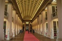 The Playfair Library Hall at Edinburgh University in Scotland. The library was designed in 1817 by architect William Playfair (1789-1857). The library hall is 190 feet long with a barrel-vaulted ceiling and served as a library from the 1820's until 1960 but is now used for functions and lectures. The busts in the niches lining the room are of past notable professors at the university.