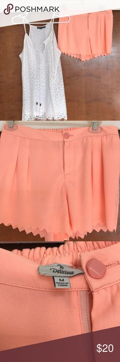 Cutie patootie coral scalloped shorts! 🌸 Darling zig-zag style scallop detailed coral shorts from a local boutique. These shorts are comfortable and have a stretch waist and are perfect for happy hour with the girlies or for dancing the night away. Thanks for shopping my closet and don't forget to bundle up for your best deal! 🌸 Delicious Shorts