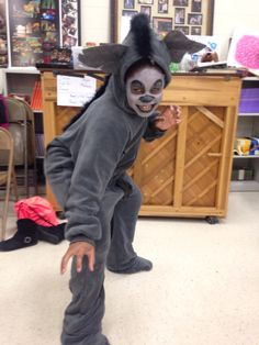 Hyenas-  footed pajamas, with leather patches, black painted smears, felt ears and  black boa attached as a mane