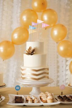 Balloon Cake Display - Read more on One Fab Day: http://onefabday.com/wedding-balloon-ideas/