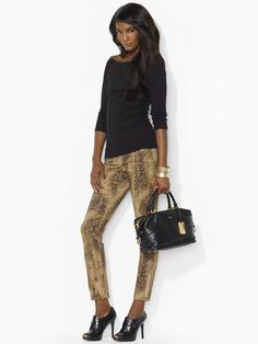 """Lauren Python Modern Skinny Jean (Style #22410796; Price: $109.00) This modern skinny jean features a bold python print and edgy zip cuffs; Sits at the natural waist. Zip fly. Single-button closure; Five-pocket styling. Zip cuffs; 29½"""" inseam. 98% cotton. 2% elastane. Machine washable. Imported."""