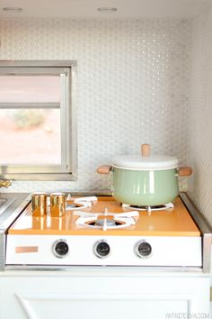 Love these tiles tiny andettalic shimmer reflection.. For a kitchen or bath . Vintage Trailer Renovation-2