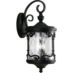 Progress Lighting P5911-80 2-Light Wall Lantern with Distressed Pepper Glass, Forged Black by Progress Lighting. $198.09. From the Manufacturer                Capturing the romance and rustic charm of a European wrought iron gate, the Augusta Collection features distressed pepper glass and a durable, die cast aluminum housing. 2-Light wall lantern with distressed pepper glass. Uses (2) 60-Watt candelabra bulbs 8-1/4-Inch Width by 19-1/8-Inch Height                  ...