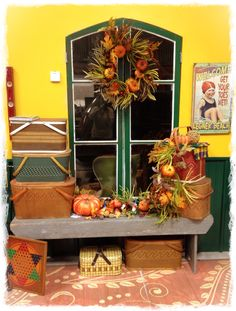 Vintage picnic baskets make great storage containers.  They hold seasonal items and party supplies.