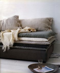 Hemp and Linen: great idea, thin  futons covered in linen to raise the couch seat on the low couch