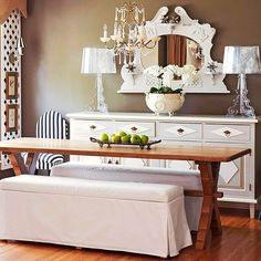 Pine Dining -'A simple farm table paired with two upholstered benches creates a contrast in the dining room. Using benches rather than traditional chairs gives the room a casual touch. The benches also conserve floor space because they tuck under the table and out of the way when not in use.