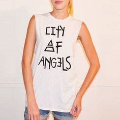 Represent the CITY OF ANGELS in this great new tee, exclusive to the Mars Store!  This fun, new, stylish tee is super soft and made by goodhYouman). Features CITY OF ANGELS print on the front, with triad detail.  Girls - wear this with leggings or your favorite jeans!  Guys - this looks great with shorts or your favorite pants.  100% lightweight cotton, made in Los Angeles, California.