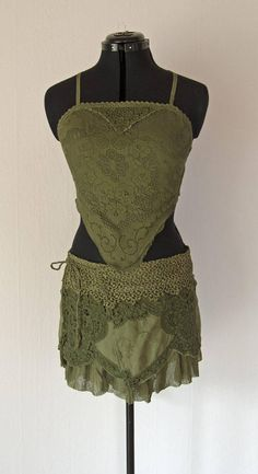 GREEN LAYERED SKIRT ruffle lace boho chic fashion This skirt is designed and sewn by a professional tailor and fashion designer This skirt is built up of cotton gauze, cotton lace, and lace trim. All hand dyed in green colors. Lots of beautiful details - wrap closure with tie bands to adjust size Measurement: Measurement: One size - can be adjusted but max hip measure 37,5 (95 cm). If your hips are smaller than 31,5 (80 cm), let me know, so I can adjust the size. If you need a bigger size...