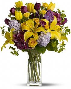 nice Spring Equinox, Celebrate the dawn of a new season with this fresh burst of color. A wide assortment of bright yellow and purple blooms are delivered in a statement vase - perfect for the spring or summer transition. ,  http://sendflowerstocalgary.com/product/spring-equinox-send-flowers-to-calgary-by-calgary-flowers/, 92.95