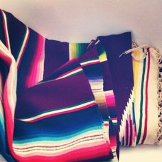 This vintage Mexican blanket sold quickly! Love the geometric patterns and bright colors.