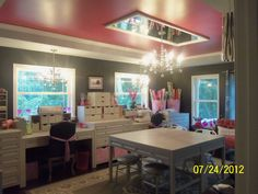 """Someones craft room. Mirror over light fixture, could be cool with a round mirror to reflect light. """"This is my new craft room. Storage cabinets are from Martha Stewart. Love my cabinets and new room."""""""