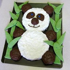 Making this cake for a customer! Looks like fun :) The bamboo is sugar cookie.