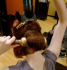 How to blow dry your hair with a round brush: 1. Apply products to protect your hair from heat or to give it more volume  2. Blow dry the hair till it's about 80% dry 3.Clip most of your hair up to leave the section you want to blow dry 4.Gently spin the round brush as it's close to your scalp while you dry it. Pull the brush up 5. Go upward on top sector of head 6. Down and forward for fringe Extra: end with blowdrying on 'cool'