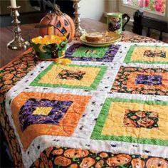 Around the Block: Quick Fun Halloween Quilt Pattern Designed by HEIDI PRIDEMORE Machine Quilted by DORIS PRIDEMORE, patterned in McCall's Quick Quilts October/November 2013