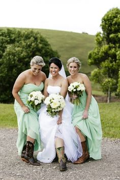 love the colour of the bridesmaids dresses! Cow girl boots with the bridesmaid dresses looks awesome!!!