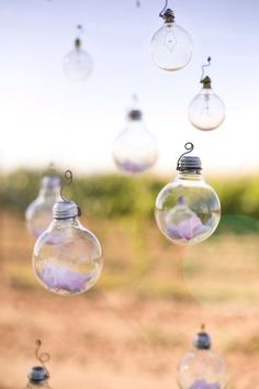 Glass bulbs with flowers in them - adorable! Would make for a great ceremony decor item and lighting amongst the flowers - beautiful