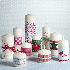 lots of ideas to decorate candles, I like the candy cane one   Decorative paper around candles