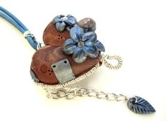 Herz an Lederband Kette Steampunk handgemacht mit Steampunk Elementen aus vintage Uhrwerkteilen Muster Blumen Blüten