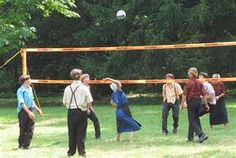 Amish teenagers play volleyball in a Pennsylvania state park.