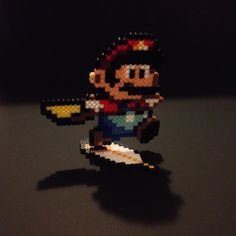 Super Mario World Perler Cape Mario with Stand by SoultwinSprites Perler Beads, Hama Beads Mario, Fuse Bead Patterns, Perler Patterns, Beading Patterns, Super Mario World, Retro Tattoos, Fusion Beads, Bead Art