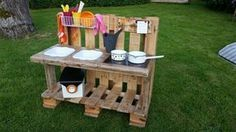 """Mud kitchen """"unique"""" for inside or outside - mamikreisel.deMud kitchen """"unique"""" for inside or outside - mamikreisel.deDIY building instructions for a Waldorf tree houseWooden toys DIY Waldorf, Waldorf tree house, natural toys, wooden toys DIY, Mud Kitchen For Kids, Kitchen Mats, Backyard Playground, Pallets Garden, Diy Toys, Diy For Kids, Kids Playing, Wooden Toys, Outdoor"""