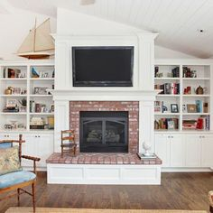 Another view of my fav fireplace and built-in bookshelves... we would nix the flat screen, however and opt for art and mantle decor.