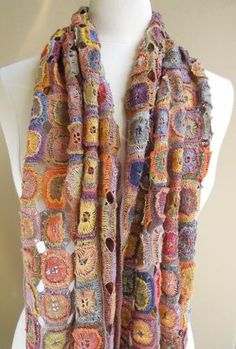 Gitane scarf    A wearable mosaic, this is the Gitane linen scarf from Sophie Digard in a rich palette of golds, apricots, lavenders, mauves, teals. 11 x 52 inches.  $305.00