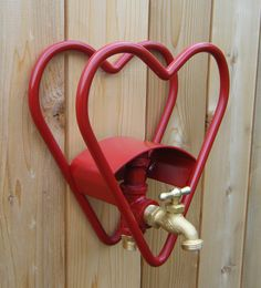 Red Heart Garden Hose Reel Holder With Faucet. $75.00, via Etsy.
