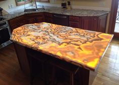 Restaurant Wine Bar With Amber Gold Onyx Countertop By