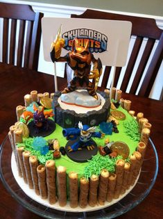 Skylanders Birthday Cake Use some of these decorations for the sheet cake (chocolate rock candy, gold coins, etc. 6th Birthday Parties, Birthday Ideas, 8th Birthday, Cake Birthday, Happy Birthday, Chocolate Rocks, Cake Chocolate, Skylanders Party, Cupcake Cakes