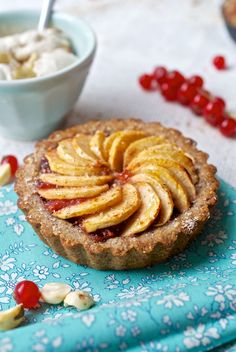 Gluten-free, vegan apple pies made of apricot jam glazed apple slices, on a cinnamony fig and apple compote, in a buckwheat, almond and haze...
