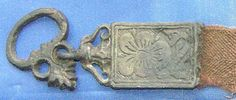 Probably 17th C (?) demicient belt fitting. Pewter casting with an embedded wire…