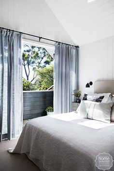 French affair: with its pitched ceiling, white panelled walls, luxurious Pottery Barn linen curtains and view-capturing balcony, the main bedroom is a beautiful and relaxing spot. Diy Curtain Rods, Diy Curtains, Bedroom Curtains, Apartment Renovation, White Paneling, Panelling, Bedroom Layouts, Cool Apartments, Trendy Bedroom