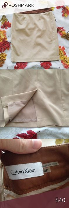 """💕LAST CHANCE Calvin Klein Leather Trim Skirt Calvin Klein latte colored skirt with cigar colored leather trim.  🛍Before you buy, I want you to know: dry clean only. Size 4p. Slit. Hidden zip.   • CONDITION: EUC. Minimal wear.     * MEASUREMENTS: (all are approximate.) waist: 15"""" length:20"""" 💖 Please ask any questions. I want you to love it!  ♥️ Pet & Smoke Free Home  📬 Usually ships in 1 business day 916tvl134 Calvin Klein Skirts Pencil"""