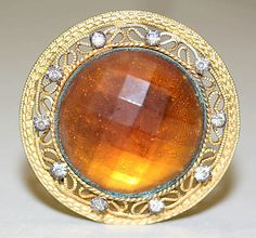 early 20th hatpin. If someone knows what the cut of the orange stone is, please let me know. I have an antique brooch with a stone cut like this, but I don't know what it's called.