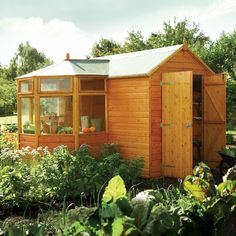 Awesome Idea for a She shed - corner greenhouse shed combo by Westmount Living