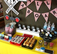 Build your own train car dessert. Cookie tracks, cake cars and candy decorations (candy rocks, licorice coal, animal crackers zoo animals, something for oil barrels....what else?)