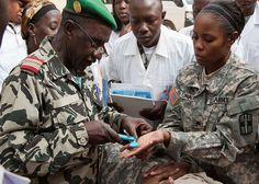 Atlas Accord 12: MOPTI, MALI -- Malian Medical Defense Forces Col. Youssouf Traore, , practices the use of a ring cutter on U.S. Army Sgt. La Tonia R. Luna, 807th Medical Detachment Support Command, and Fort Worth, Texas native, during a medical equipment demonstration in Mopti, Mali, Feb. 7. The 807th MDSC were in Mali as medical support for the Atlas Accord 12 exercise. (U. S. Army photo by Spc. Kimberly Trumbull.)