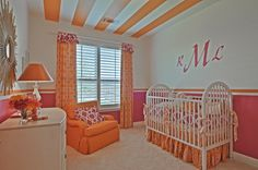 This vivid orange and hot pink nursery design from Highland Homes features a sweet monogram above the crib and bright coordinating bedding/accents. Plan 245, Arbors at Willow Bay, Frisco, TX.