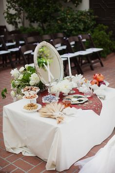 At a Persian wedding there is a Sofreh Aghd, a table with items that represent the couple's new life together.