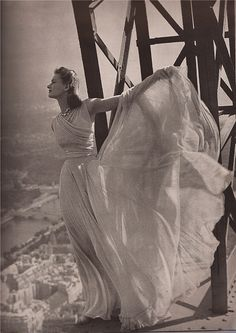Molyneaux's pale gray chiffon blows out over Paris...the long gloves are gray suede...the jewels are by Mauboussin    Harper's Bazaar September 1939  Photography:Irwin Blumenfeld
