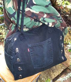 Another up-cycled mini duffel bag made from black Levi's jeans, with skull studs