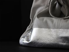 Remade: Silver-Leafed Leather Bag DIY >> http://blog.diynetwork.com/maderemade/how-to/remade-silver-leafed-leather-bag/?soc=pinterest