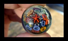 Lampworked borosilicate seafloor marble made by artist Nelson Doty of Mandella Glass.